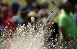 Victor Dubuisson of France hits from a sand trap on the seventh hole during first round play of the Masters golf tournament at the Augusta National Golf Course in Augusta